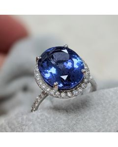 Pre-Owned 18ct White Gold Tanzanite and Diamond Halo Cluster Ring